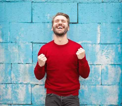 man in red crew neck sweatshirt photography